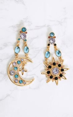 Gold Moon & Star Gem EarringsAdd instant glam to your look girl with these statement earrings. Wi...