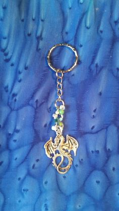 Check out this item in my Etsy shop https://www.etsy.com/uk/listing/244522957/dragon-beaded-charm-keychain