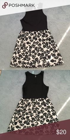 Francesca's Collection Black and White Dress This Francesca's Collection dress has a black top with a black and white floral bottom. There is a small loophole back that closes with a button. Worn once! 85% polyester, 13% rayon, 2% spandex. PRICE IS NEGOTIABLE! Francesca's Collections Dresses Mini