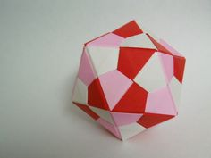 """Create your own nerdy icosahedron with some simple modular origami. Ok, technically it's not """"origami"""" origami because the units are made of rectangle pieces of paper but if you call it origami I won't hold it against you :) It can take awhile to fold all the units for this little guy but I think the end product is worth it."""