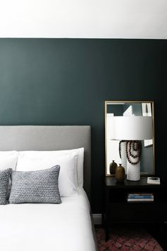 Minimalist bedroom with dark green walls - gorgeous!! Paint color is Crisp Romaine by Benjamin Moore.