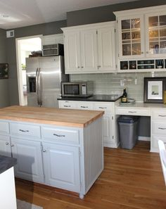 Oh So Lovely: Our $500 DIY Kitchen Remodel. Concrete layer counter and cabinet painting how to