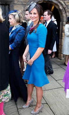 April 27, 2013  Pippa in an azure blue dress by Matthew Williamson, accessorized with a gray fascinator and suede heels.