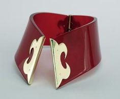 Kyung Ha Lee, Red Collar, 2013, necklace, red plexiglass, brass, steel wire, 3 x 5.5 x 7 inches, photo: David Butler