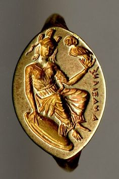 "Gold signet ring on the bezel Athena seated with an Owl - found Cyprus, circa 4th c BC, Greek inscription reads ""Anaxiles"""