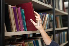 48670720-a-book-picked-or-taken-with-a-hand-from-a-book-shelf-in-the-library-a-concept-of-learning-and-choice.jpg (450×301)