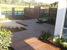 Deck off the back of the house - would it be easier than leveling dirt & laying pavers / concrete