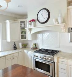 kitchen backsplash new tile...love the shelf above the oven and the tile work. It makes the oven look more high end.