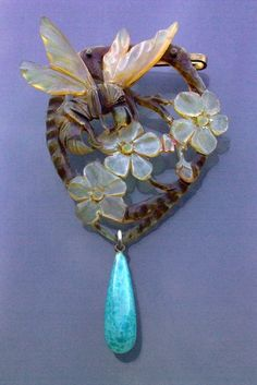Elizabeth Bonte horn and blue glass pin
