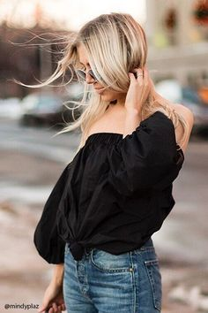 A cotton woven top featuring an elasticized off-the-shoulder, a knotted front, 3/4 lantern sleeves with elasticized cuffs, and a boxy silhouette. This is an independent brand and not a Forever 21 branded item.