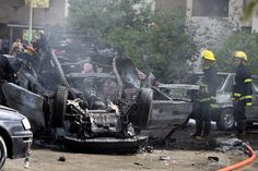 Oct 7, 2008 Iraqi firefighters extinguished an exploded car bomb at a parking lot near the Iraqi Foreign Ministry in Baghdad Tuesday. Two powerful bombs exploded outside the area's tightly guarded Green Zone as U.S. Deputy Secretary of State John Negroponte was due to address reporters. (Ahmad al-Rubaye/Agence France-Press — Getty Images)