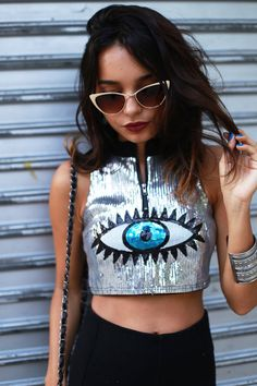 Blogger Alana Ruas wearing a silver sequin crop top + cat-eye sunglasses