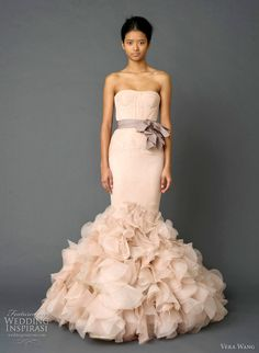vera wang wedding dresses spring 2012 - Pale pink strapless mermaid gown with pleated chiffon bodice, tissue organza blossom peplum with draped petal technique detail and grosgrain multi-bow sash.