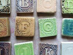 The Whole Alphabet!  26 assorted colored ceramic magnet letters    These 1 x 1 tiles are made from imprinting letters from baby blocks on clay to