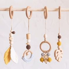 These cute baby rattles look amazing on our wooden baby gym! Wouldn't you love to see your little one play around and enjoy them for hours? These beautiful rattles and teethers are just what your child needs on his/her baby gym or even just hanging on his/her crib! Apart from them being super decorative due to the hig Homemade Baby Gifts, Baby Gifts To Make, Baby Girl Gifts, Custom Baby Gifts, Unique Baby Gifts, Personalized Baby Gifts, Baby Gym, Baby Teethers, Baby Rattle