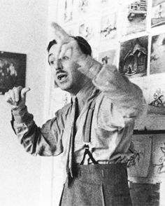 As Walt Disney talked his artists through the story of Pinocchio, he played each of the characters. Here he acts out the scene in which the little puppet sinks to the bottom of the sea, 1939.