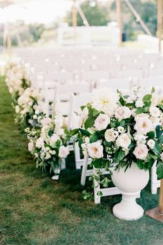 """From the editorial """"A Stylish and Effortlessly Glamorous Wedding Tucked Away on a Private Island."""" At the end of the aisle were two oversized white urns overflowing with white hydrangea, roses, dahlias and greenery. You can find more floral arrangements from this summer wedding on stylemepretty.com!  Photography: @elizabethladuca  #weddingflowers #weddingflorals #weddingceremony #ceremonyflowers #summerwedding"""