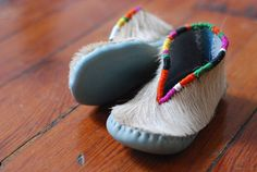 These look pretty nice for the kids, warm hair on hide moccasin style shoes