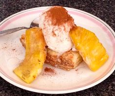 Grilled Pineapple Shortcake with Vanilla Ice Cream .. made this up last night; scratch shortcake, glaze fresh pineapple with honey and OJ then grill 'em; good vanilla bean ice cream; top with a drizzle of coconut milk, a big pinch of sugar and heavy dash of cinnamon.