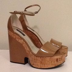 """New Dolce & Gabbana Tan Patent Platform sandal Gorgeous Tan Patent Leather Platform Heels. Unique cork detailing at platform leading up to heel, and most of heel  is patent leather.  Closed heel, Open Toe sandal design with a slim 3/16"""" ankle strap with silver buckle closure . 4.5"""" Heel, 1.5"""" platform. New without box. EURO Size 38.5. Dolce & Gabbana Shoes Platforms"""