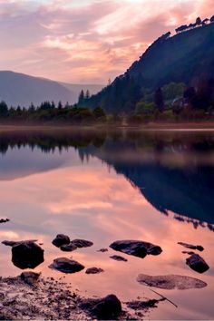 The sun sets upon Glendalough as seen from Upper Lake, Glendalough, Ireland