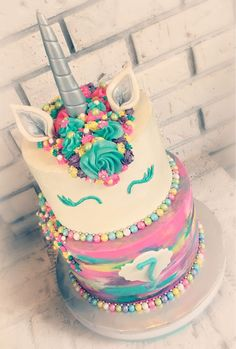 Unicorn rainbow buttercream tiered cake