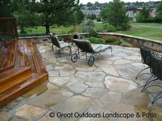 What about composite wood steps leading to a flagstone patio?  Cost savings on the steps could help pay for the patio now.