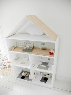 Dolls house - adapt an IKEA Billy bookcase with glass doors, add windows and a side entrance. Dolls house - adapt an IKEA Billy bookcase with glass doors, add windows and a side entrance.