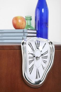 Dali Surrealism Clock - so cool & at $20.00, a very affordable way to add a touch of art to your home/office.
