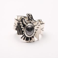 The 925 sterling silver eagle ring is richly handcrafted, with Navajo inspired patterns on a Damascus steel 'gemstone'.   #handmade #jewelry #nativeamerican #ring #handcraft #sterlingsilver #etsy #handmadejewelry #fashion #style #navajo