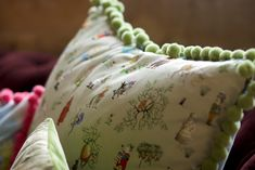 """""""Wonderland Cushions"""" by Mary Gannon Design featuring Samuel and Sons pom pom fringe. The collection commemorates the 150th anniversary of Alice's Adventures in Wonderland.  www.samuelandsons.com"""