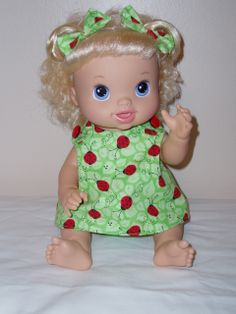 "Her name is ""Krista"", she is named after a little girl in Steubenville, she is wearing a light green jumper with lady bugs on it and lady bug buttons at the shoulders"