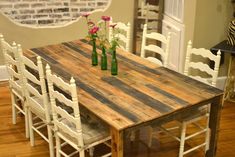 Harvest-style dining table made from shipping pallets. I need a new dining room table and love these harvest ones. This one is gorgeous.