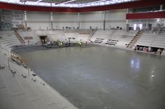 It's a HUGE day at La Bahn Arena as the pouring of the arena floor is going on. Started at about 3 a.m. They had gotten pretty far by 7:30 a.m. It is one continuous pour, then they wait a month for it to cure.