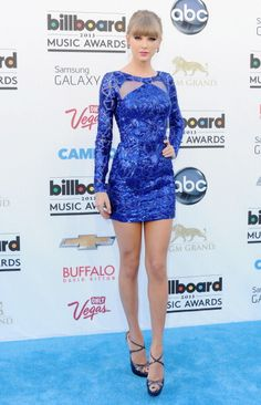 In a Zuhair Murad mini dress at the 2013 Billboard Music Awards. See Taylor Swift's full fashion evolution, from sequins in 2007 to her many crop tops today.