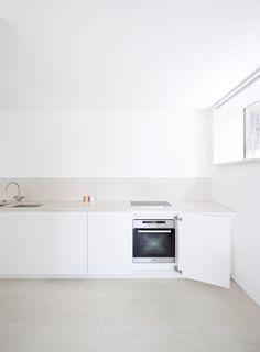 white minimal kitchen    HOUSE O, Interior Design    2009, Kronberg, Germany oven behind a door!