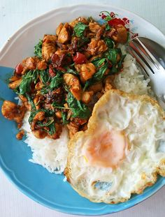 Authentic Thai (Holy) basil chicken recipe with fried egg (pad kra pao gai ผัดกระเพราไก่)