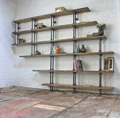 I've just found Emilie Asymmetric Reclaimed Scaffolding Shelves. Asymmetric Reclaimed Scaffolding Boards and Dark Steel Pipe Shelving/Bookcase - Its salvaged vintage industrial design works perfectly in a sophisticated, casual living space.. £1,995.00