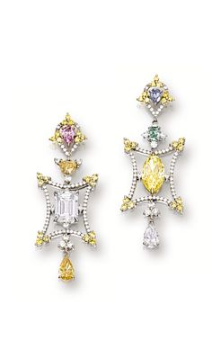 PAIR OF COLOURED DIAMOND AND DIAMOND PENDENT EARRINGS.  The asymmetrical pair of earrings, set to one side with an emerald-cut diamond, set to the other side with a marquise-shaped fancy intense yellow diamond, enhanced by variously-shaped diamonds of fancy intense yellow-orange, fancy orange-yellow, fancy intense purplish pink, fancy vivid green and fancy grayish blue diamonds and colourless diamonds, to a stylised frame set with brilliant-cut diamonds and yellow diamonds.