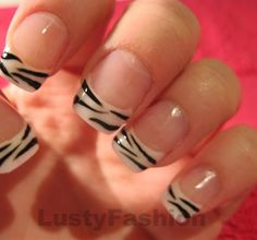 Zebra print tips -- oh boy, you know what i'm doing if i grow my nails out