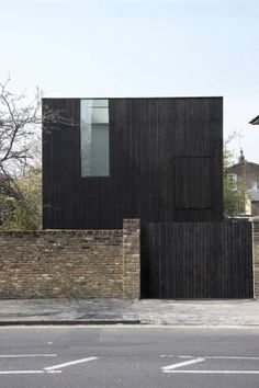 Sunken House by Adjaye Assocates in northeast London. The timber used to clad the exterior has been stained a rich, dark brown and hemp was used to insulate the walls.