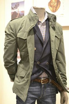Cool color combo. Looks like a thin double breasted blazer underneath the jacket - a bit much for presumably a casual look but a navy sweater could work just as easily instead