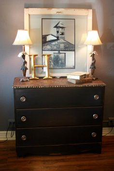 We refinished a small chest of drawers in a tastefull black and used Wood Icing texture to create a faux crocodile top! It is bordered with vintage studs to give it a realistic leather look! One of our favorites!