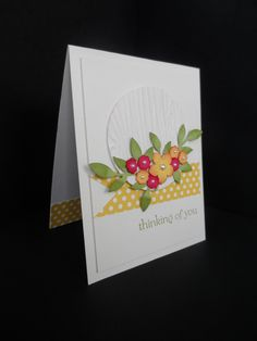 Crisp White Card with bright spring flowers popping right off the card.... hope you like it.