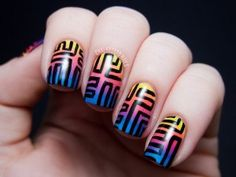 Tribal inspired Ombre nail art. Combine rainbow colors for your Ombre nail art and highlight them by using bold black lines to create tribal designs on top.