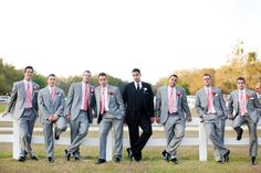 Gray and coral groomsmen // photo by Wings of Glory Photography