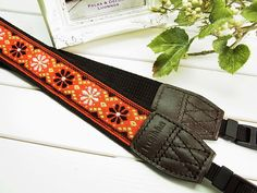red pure daisy camera strap