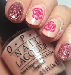 Floral nails with pink glitter.
