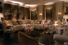 Mario Buatta ~ Buatta transformed superstar Mariah Carey's triplex in Manhattan into an opulent oasis. Gold accents, a mirrored cocktail table, and beaded pillows gleam and glimmer in the living room, shown