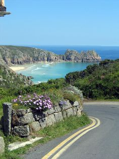 Coast road, Cornwall. Photo about cliffs, coast, summer, view, cornwall, waves, flowers, road, countryside, lane, surf, beach, cove, england - 12417698